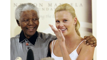 032813-global-nelson-mandela-with-his-famous-friends-Charlize-Theron